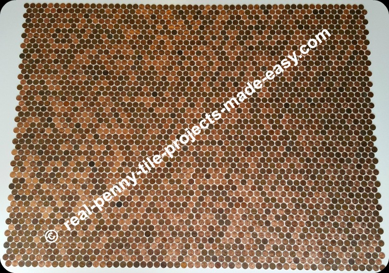 12 tile sheets of pennies perfectly interlocked.