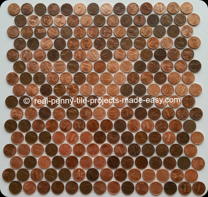 Tile sheet of real random pennies on mesh. It's the real penny round tile.