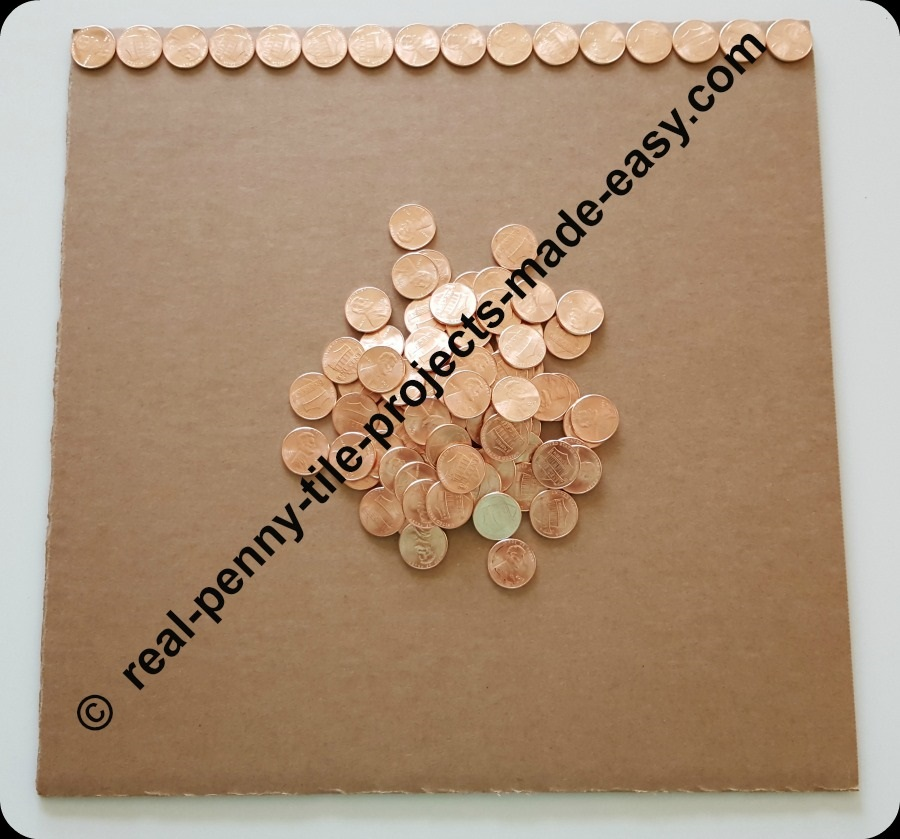 16 pennies fit on the side of a 12 inch cardboard.