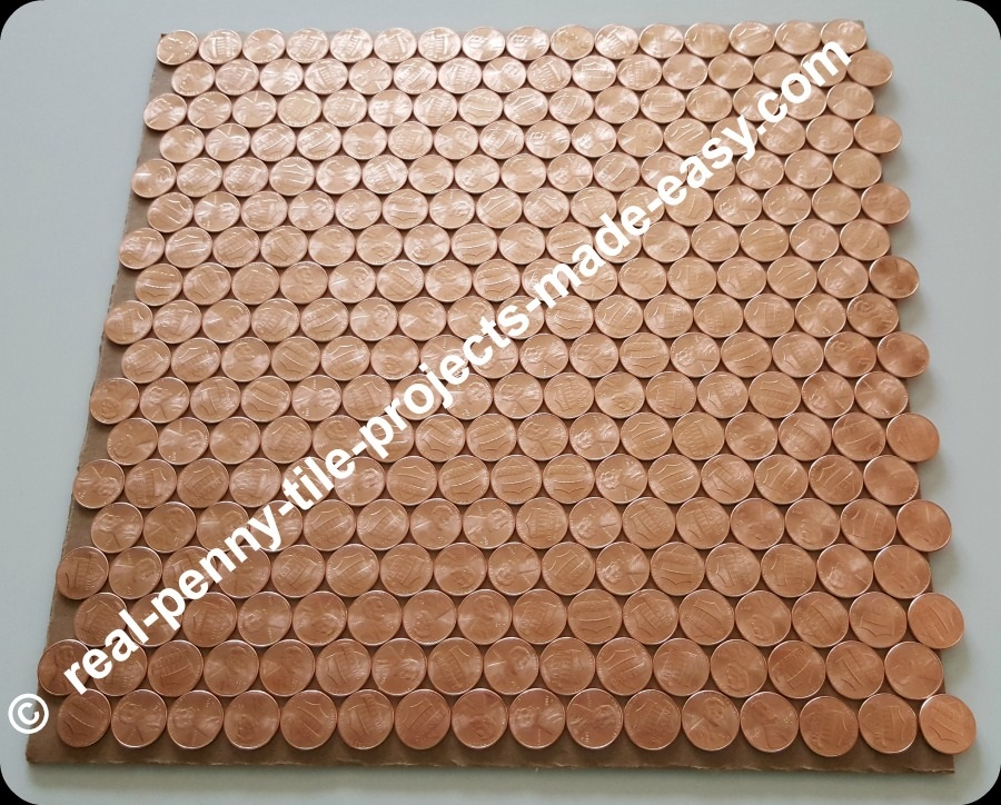 18 offset rows of 16 pennies each can fit in 1 SF plus extra room left.