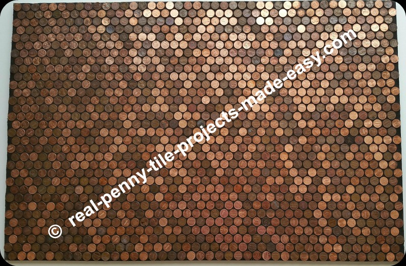 Black sanded grout applied to pennies as tile.