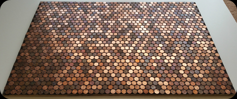 Grouted pennies as tile on sample floor.