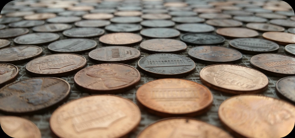 Close-up view of pennies glued to floor.