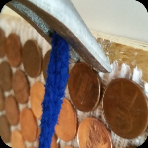 Pennies as tile on wall -installation strength check-