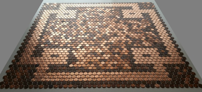 Handmade design made with new shiny pennies next to random shades of old and new pennies on mesh backing.