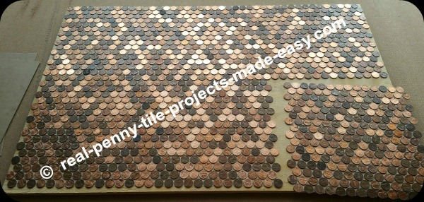 Six sheets of pennies covering a floor.