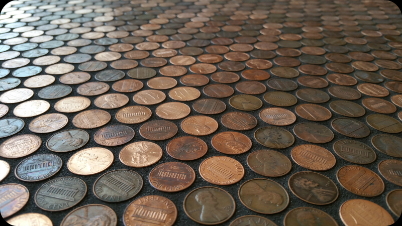 1 cent coins glued to floor, grouted in black.