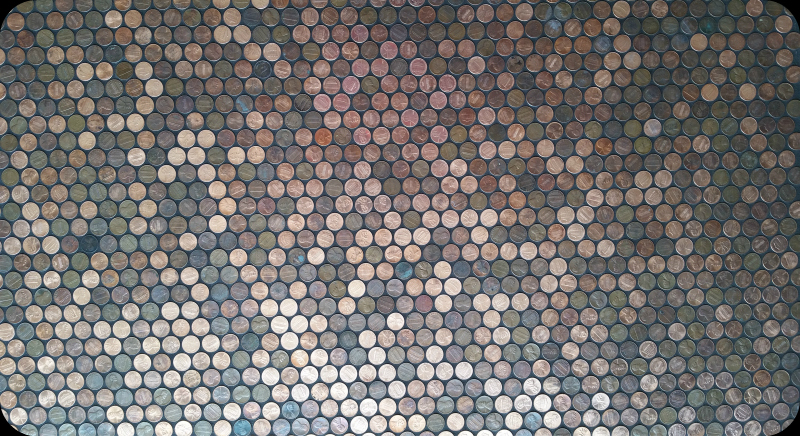 Lots of pennies covering a floor grouted in black.