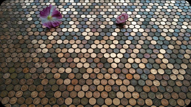 Flowers on floor of pennies.