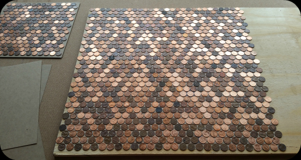 Four sheets of pennies covering floor.