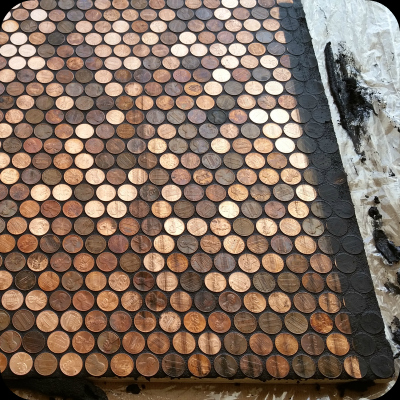 Washing grout off of pennies.