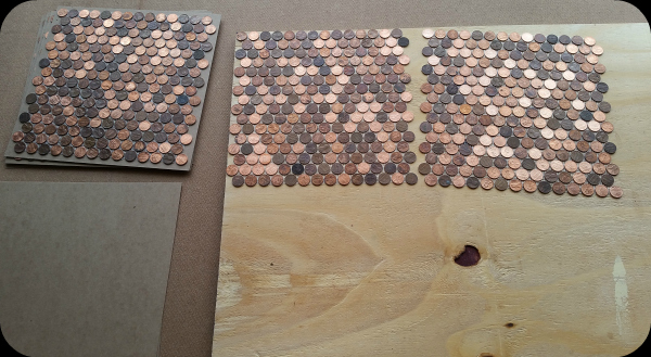 Installing pennies as tile on floor.