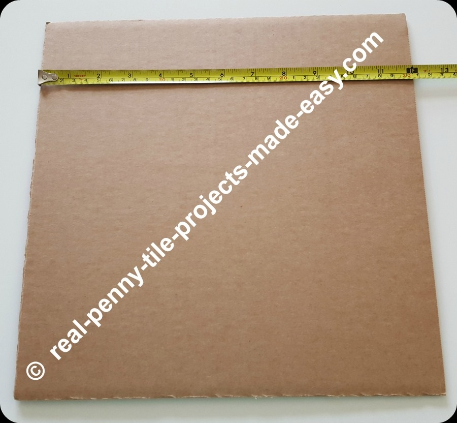 12x12 in. cardboard showing tape measure at 12 inches.