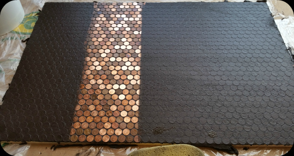 Grout Covering Pennies On Floor.