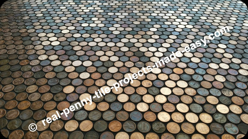 Grout on floor covered in pennies.