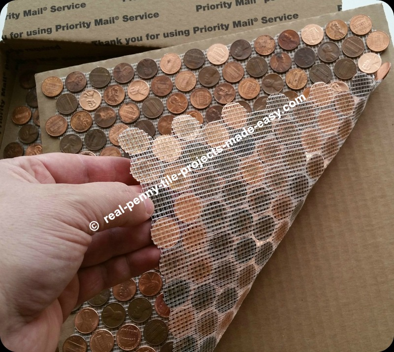 Mesh backing covers all pennies on the edges of this real penny tile sheet made with random (copper) pennies/coins.