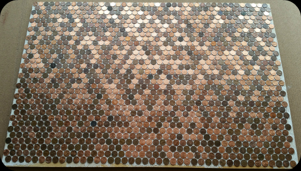 Six sheets of pennies as tile glued to floor about to be grouted.