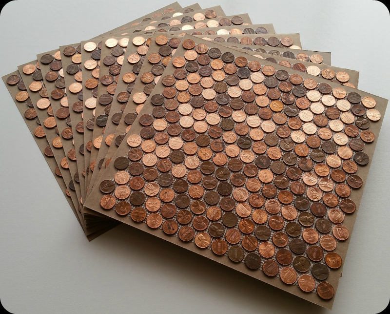 Tile sheets of pennies out of the box ready to be installed.