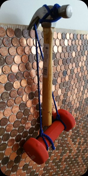 Adhesive strength check of pennies as tile on wall.