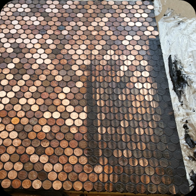 Cleaning grout from pennies.