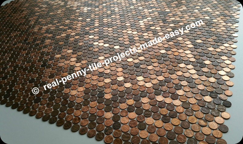 Amazing view of 12 real penny tile sheets interlocked in a dry-fit before installation.