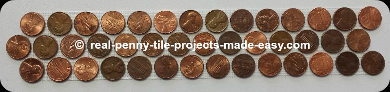 3-rows of pennies on mesh as decorative penny round mosaic tiles.