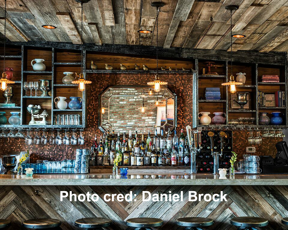 Bar wall / backsplash gets lots of pennies installed for the best rustic/antique look together with the decor.