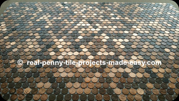 Pennies glued to floor, not grouted yet.