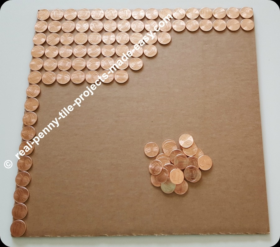 Filling up a square foot area with brand new shiny uncirculated pennies.