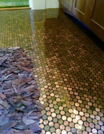 Bathroom floor covered with standard sheets of pennies made with random old and new pennies.