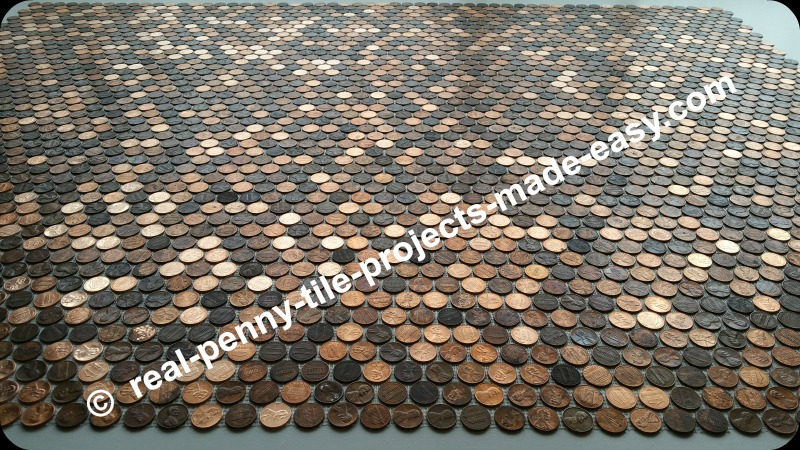 Dry fit of 12 real penny tile sheets made with (copper) coins/pennies.
