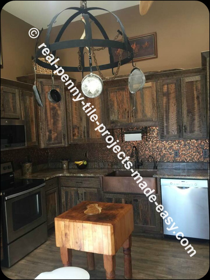 Rustic themed kitchen including backsplash made with real pennies installed as tile sheets and grouted.