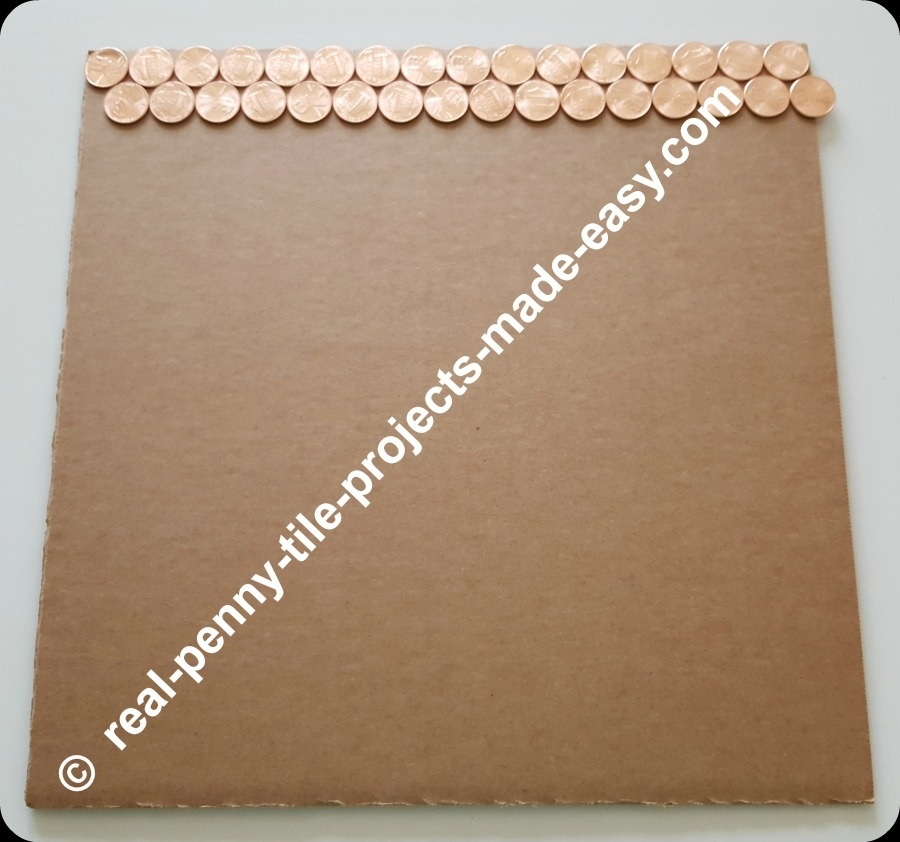 Beginning of staggered/offset rows of pennies.