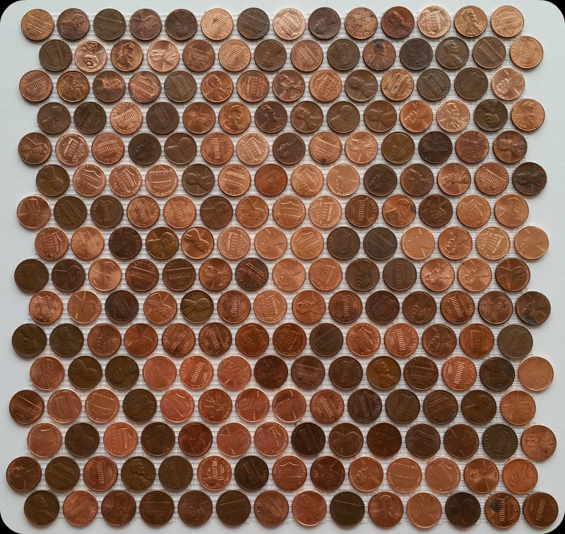 Interlocking tile sheets made with real coins / pennies attached to mesh.